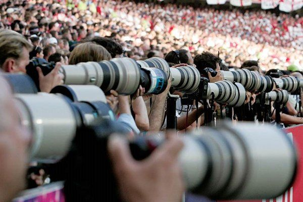 Image of a sports match with many dslr's and some amazing lenses